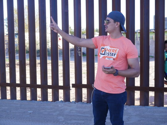 Luis Leyva at the border fence in southern New Mexico.