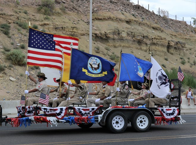 In this file photo, veterans of foreign wars ride on a float, Aug. 9, during the San Juan County Fair Parade in Farmington, N.M. A VA town hall will be held Aug. 20 at the Wichita Falls Regional Airport.