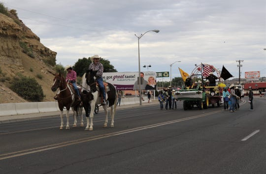Members of the San Juan County Sheriff's Posse participate in the San Juan County Fair Parade, Friday, Aug. 9, 2019, in downtown Farmington.