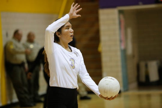 Kirtland Central's Gabrianna White-David prepares to serve the ball to Aztec during a Distict 1-4A match on Tuesday, Oct. 30, 2018, at KCHS.