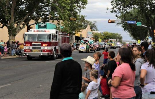 Community members watch the San Juan County Fair Parade, Friday, Aug. 9, 2019, in downtown Farmington.