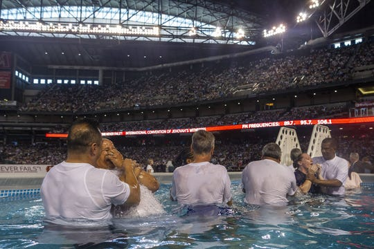 Over 400 people were baptized during the 2019 Jehovah's Witness Convention, with 40,000 attendants watching at Chase Field in Phoenix, Ariz., on Aug. 10, 2019.