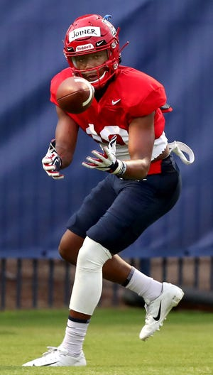 University of Arizona receiver Jamarye Joiner prepares to cradle a catch while running routes drills with the quarterbacks as the Wildcats go into their third week of pre-practice, Tucson, Ariz., August 6, 2019.