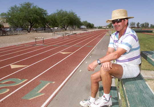 Central Arizona College distance coach George Young poses on the school's track on April 27, 2000. Young, a former Olympian, was instrumental in turning the small school into a national powerhouse.