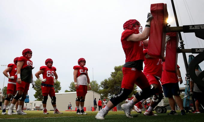 The offensive linemen hit the sled during day seven of the University of Arizona's pre-season practices, Tucson, Ariz., August 2, 2019.