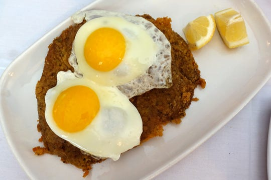 "Steak milanesa ""completa"" with fried eggs at La Esquina Argentina in Mesa."