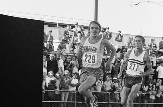 With Olympic veteran George Young trailing him closely Oregon's Steve Prefontaine heads into the final two laps July 9,1972 in Eugene, Ore., where he cracked the American record in winning the Olympic Trials 5,000 meters. Young, 34, coach at Central Arizona College who would go on to compete in his fourth Olympics that year, held on for second, but finished well behind. Prefontaine, who was a University of Oregon junior, won in a time of 13 minutes, 22.8 seconds, besting his own mark by seven seconds.