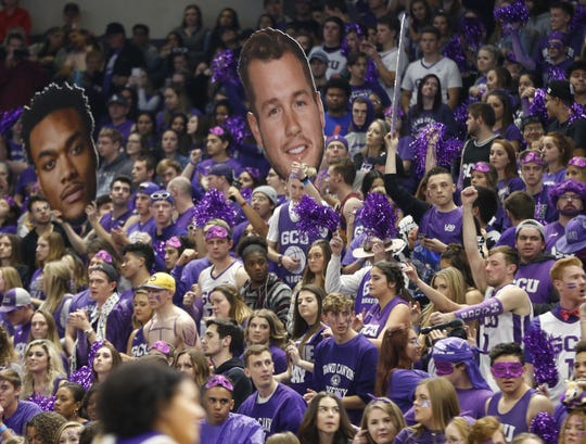 """GCU fans hold up a face of current """"Bachelor"""" Colton in the audience during the second half at Grand Canyon University Arena in Phoenix, Ariz. on February 9, 2019."""