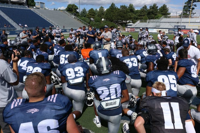 Nevada head coach Jay Norvell addresses his team during a recent Wolf Pack practice at Mackay Stadium.