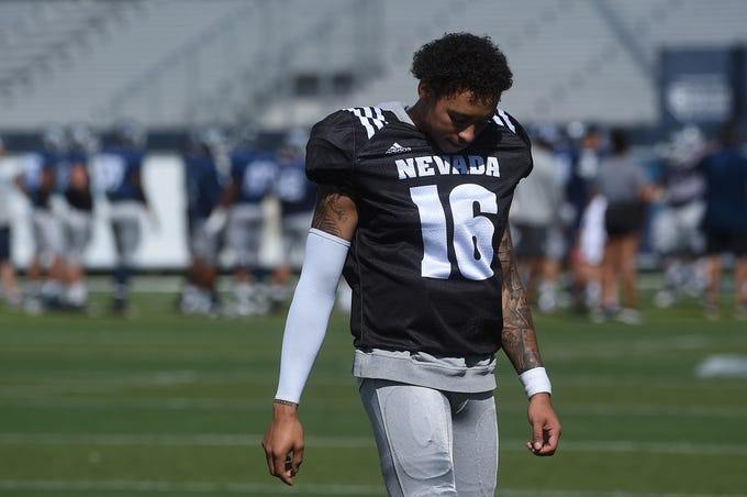 Nevada quarterback Malik Henry walks to the sidelines during practice and scrimmage at Mackay Stadium in Reno on Aug. 10, 2019.