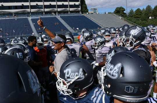 Head coach Jay Norvell runs a Nevada football practice and scrimmage at Mackay Stadium in Reno on Aug. 10, 2019.