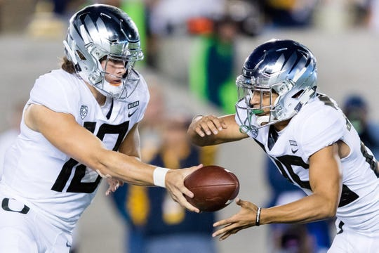 Sep 29, 2018; Berkeley, CA, USA; Oregon Ducks quarterback Justin Herbert (10) hands off to running back Travis Dye (26) in the game against the California Golden Bears in the second quarter at California Memorial Stadium. Mandatory Credit: John Hefti-USA TODAY Sports