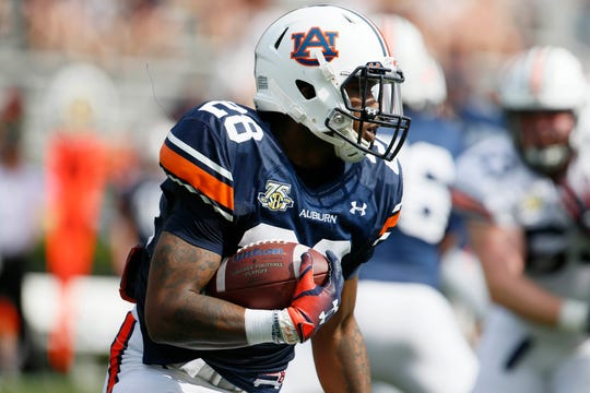 Apr 13, 2019; Auburn, AL, USA; Auburn Tigers running back JaTarvious Whitlow (28) carries during the second quarter of the A-Day game at Jordan-Hare Stadium. Mandatory Credit: John Reed-USA TODAY Sports
