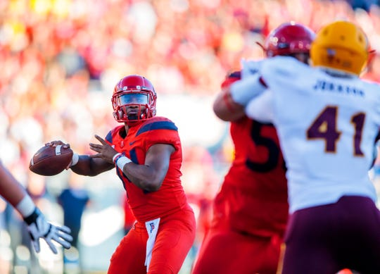 Nov 24, 2018; Tucson, AZ, USA; Arizona Wildcats quarterback Khalil Tate (14) against the Arizona State Sun Devils during the Territorial Cup at Arizona Stadium. Mandatory Credit: Mark J. Rebilas-USA TODAY Sports