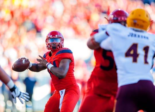 Nov 24, 2018; Tucson, AZ, USA; Arizona Wildcats quarterback Khalil Tate (14) against the Arizona State Sun Devils during the Territorial Cup at Arizona Stadium. Mandatory Credit: Mark J. Rebilas-USA TODAY Sports
