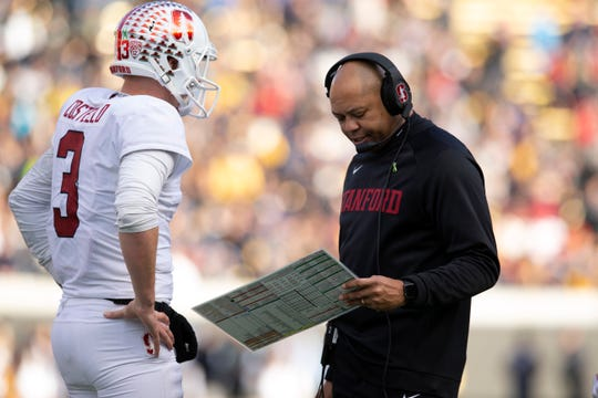 Dec 1, 2018; Berkeley, CA, USA; Stanford Cardinal head coach David Shaw confers with quarterback K.J. Costello (3) in the fourth quarter of the 121st Big Game at California Memorial Stadium. Mandatory Credit: D. Ross Cameron-USA TODAY Sports