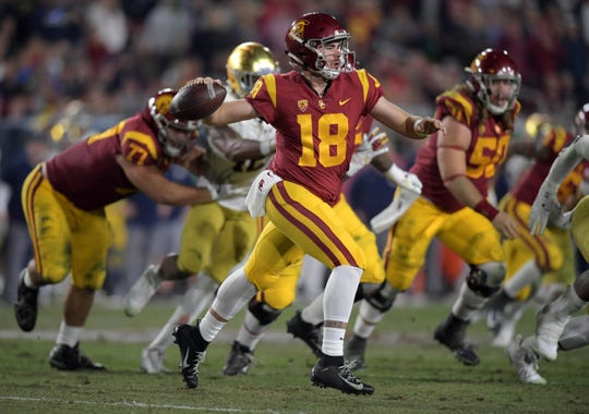 Nov 24, 2018; Los Angeles, CA, USA; Southern California Trojans quarterback JT Daniels (18) throws a pass in the second half against the Notre Dame Fighting Irish at Los Angeles Memorial Coliseum. Notre Dame defeated USC 24-17. Mandatory Credit: Kirby Lee-USA TODAY Sports