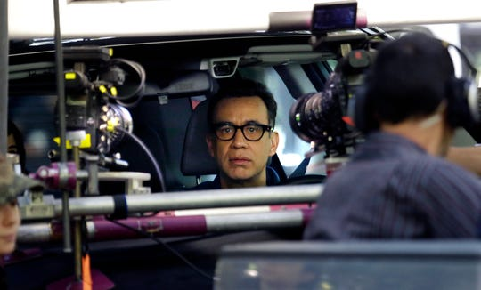 "Actor Fred Armisen prepares to film a scene for ""Portlandia"" in a car with co-star Carrie Brownstein in Portland, Ore., Sept. 18, 2015. Brownstein and Armisen conceived the series with fellow executive producer Jonathan Krisel, and the two of them play various and sundry characters."