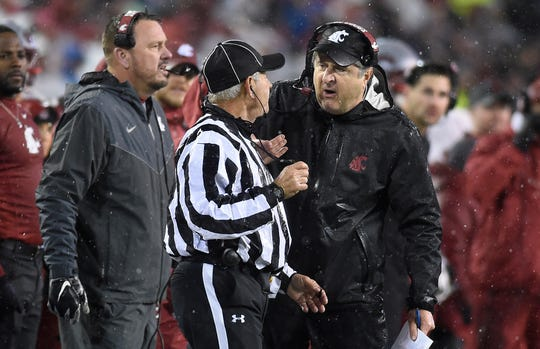 Nov 23, 2018; Pullman, WA, USA; Washington State Cougars head coach Mike Leach talks with a referee during a football game against the Washington Huskies in the first half at Martin Stadium. Mandatory Credit: James Snook-USA TODAY Sports