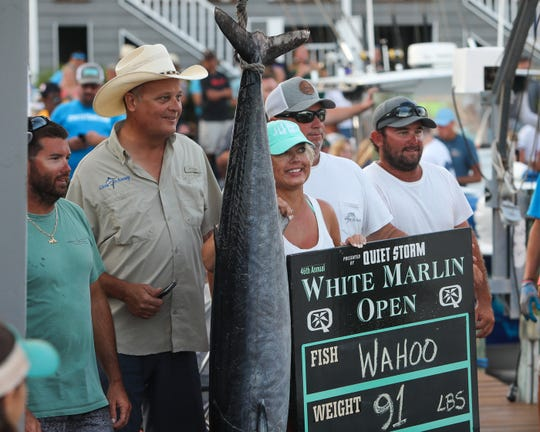 Anne Aramendia and the crew of the Give it Away at the scales with a 91-pound Wahoo caught during the White Marlin Open on Friday, Aug. 9. This was the third-largest dolphin ever caught in the White Marlin Open's 46-year history.