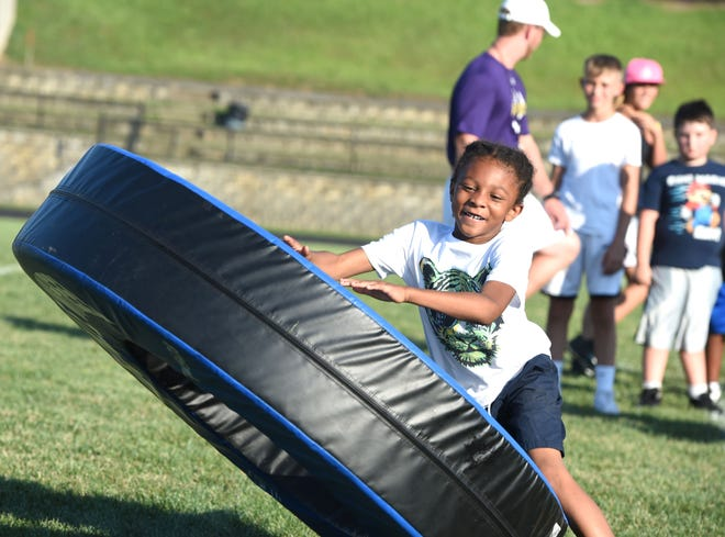 The tackle wheel was just one of the pieces of equipment the Waynesboro youth football players got to work with Friday during a clinic run by the Little Giants varsity team.