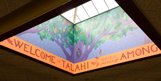 A mural below the skylight at Talahi Community School signals their motto of unity Thursday, Aug. 8, 2019.