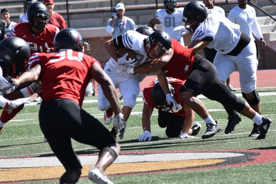 Defensive players fly to the ball carrier during one of SUU's fall camp scrimmages.