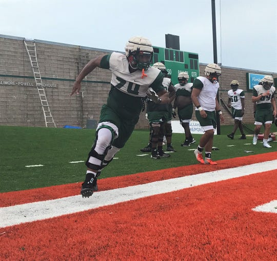 FAMU offensive linemen Zach Saffold works on his lateral movement in pulling during practice.