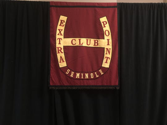 An original banner for the Extra Point Club on display at Friday's banquet celebrating 40 years of support.