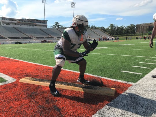 FAMU offensive lineman Keenan Forbes practices his pass blocking during a board drill.