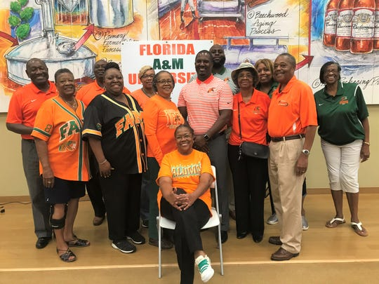 Football head coach Willie Simmons poses with members of the FAMU NAA Gadsden County Chapter during the Willenium Tour.