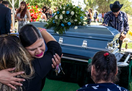 8/9/19 2:31:30 PM -- El Paso, TX  -- Family and friends console each other during the funeral service of Juan De Dios Velasquez, at Mount Carmel Cemetery in El Paso, Texas on Friday, August 9, 2019. Velasquez was one of 22 people killed in the Saturday, August 3 massacre at anÊEl PasoÊWalmart.  --    Photo by Nick Oza, Gannett