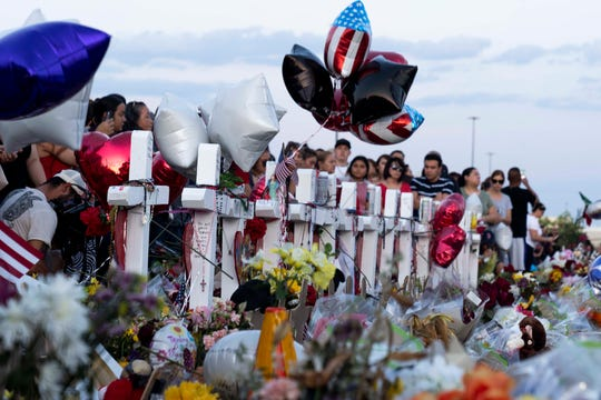 Hundreds of people came to mourn, laying flowers and candles, praying for the victims and their family outside Walmart in El Paso, Texas., on August 6th, 2019. Mass shooting claims 22 lives inside and outside Walmart.