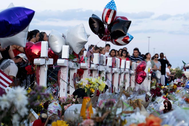 Hundreds of people went to mourn, laying flowers and candles, praying for the victims and their families, on Aug. 6, 2019, outside the East El Paso Walmart where nearly two dozen people were killed Aug. 3, 2019.
