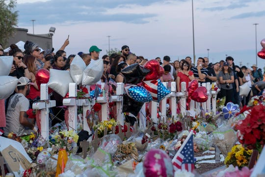 Hundreds of people came to mourn, laying flowers and candles, praying for the victims and their families outside Walmart in El Paso, Texas., on Aug. 6, 2019. The mass shooting Aug. 3, 2019, claimed 22 lives; 25 people were injured.