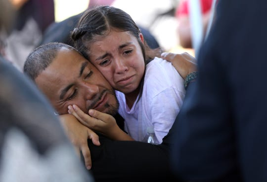 Family members grieve at the funeral of Juan de Dios Velásquez on Friday, Aug. 9, 2019, at Mount Carmel Cemetery in El Paso, Texas. He was killed in the Walmart shooting on Aug. 3, 2019.