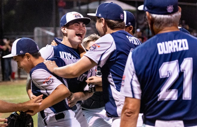 Visalia Blue's Sebastian Osejo (10) and teammates celebrate their win over South Bend in the 2019 Cal Ripken Major 60' World Series championship in Visalia at Riverway Sports Park on Friday, August 9, 2019.