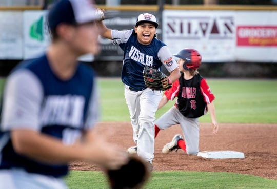 Visalia Blue's Sebastian Osejo celebrates outing South Bend's Jacob Barber at second during the 2019 Cal Ripken Major 60' World Series championship in Visalia at Riverway Sports Park on Friday, August 9, 2019.