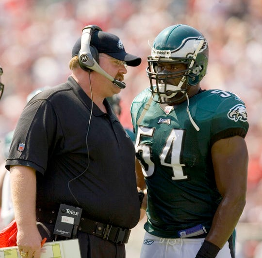 Oct 22, 2006; Tampa, FL USA; Philadelphia Eagles head coach Andy Reid talks with linebacker (54) Jeremiah Trotter on the sidelines during the 1st half against the Tampa Bay Buccaneers at Raymond James Stadium in Tampa, Florida. Mandatory Credit: Paul Abell-USA TODAY Sports Copyright © Paul Abell