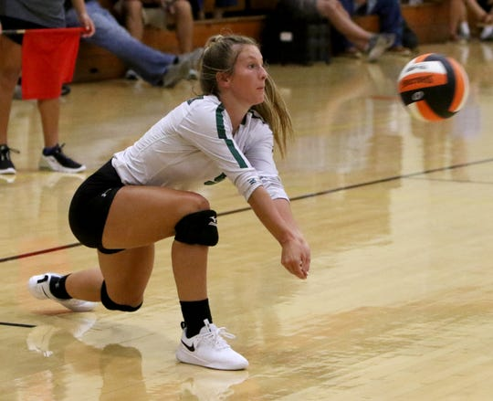 Iowa Park's Brianna Payton receives the Classen serve Friday, Aug. 9, 2019, at the Cool in Boomtown tournament in Burkburnett.