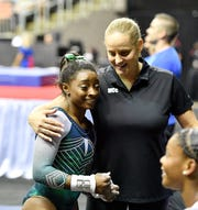 Olympic champ Simone Biles with one of her coaches, Cecile Canqueteau-Landi,  after a frustrating performance on the uneven bars at the  2019 U.S. Gymnastics Championships at Sprint Center.