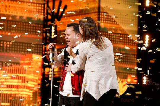 Singer Kodi Lee, left, gets a hug from his mother, Tina, after receiving a golden-buzzer advancement after his 'America's Got Talent' audition in May. He will return to the stage for the first live show on Tuesday.
