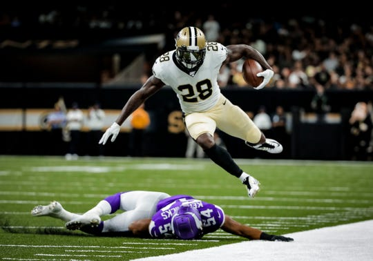 New Orleans Saints running back Latavius Murray leaps over Minnesota Vikings middle linebacker Eric Kendricks.