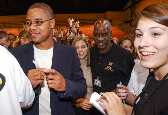 Award winning actor Cuba Gooding, Jr., left, signs autographs at a T.L. Hanna football pep rally in October 2003.  A red-carpet premiere of Radio, featuring Gooding, Jr., was at AmStar 14 cinema October 24, 2003.