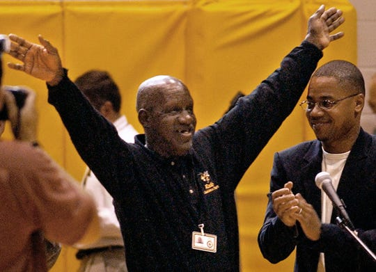 """""""James 'Radio' Kennedy, left, waves to students next to Cuba Gooding, Jr., during a pep-rally at T.L. Hanna High School in Anderson in 2003. Gooding, Jr., later joined Kennedy on the red-carpet movie premiere at the local theater."""