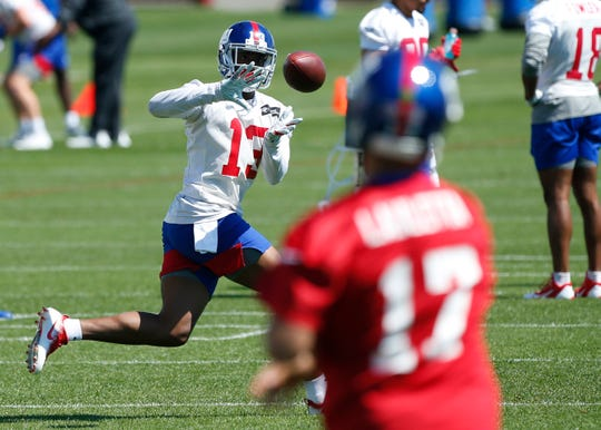 New York Giants wide receiver Reggie White Jr. (13) makes a catch during mini camp at Quest Diagnostic Training Center.