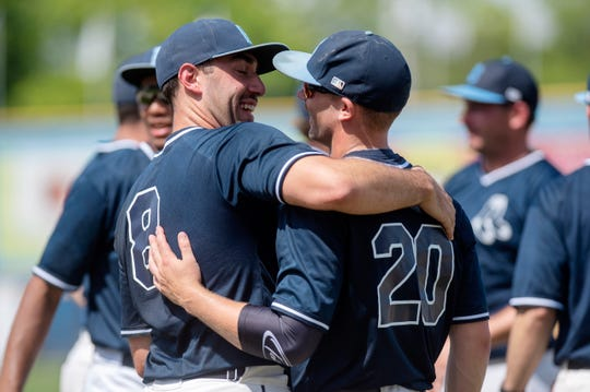 Matt LaRocca (8) and Jake Plata (20) embrace after they win the 2019 NABF World Series on Sunday, Aug. 11 at C.O. Brown Stadium in Battle Creek, Mich. The Berea Blue Sox won the championship against the Brunswick Orioles, 10-6.