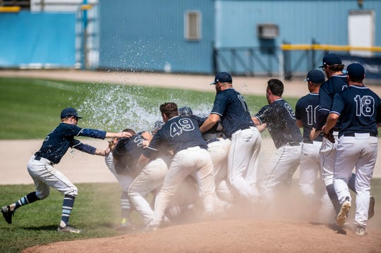 The Berea Blue Sox celebrate winning the 2019 NABF World Series on Sunday, Aug. 11  at C.O. Brown Stadium in Battle Creek, Mich. The Berea Blue Sox won the championship against the Brunswick Orioles, 10-6.