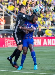 Aug 10, 2019; Columbus, OH, USA; FC Cincinnati goalkeeper Przemyslaw Tyton (22) collides with defender Kendall Waston (2) whil emaking a save against Columbus Crew SCat MAPFRE Stadium.