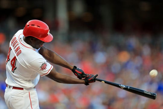 Cincinnati Reds' Aristides Aquino hits a solo home run, his second home run of the game, in the third inning of a baseball game against the Chicago Cubs, Saturday, Aug. 10, 2019, in Cincinnati.